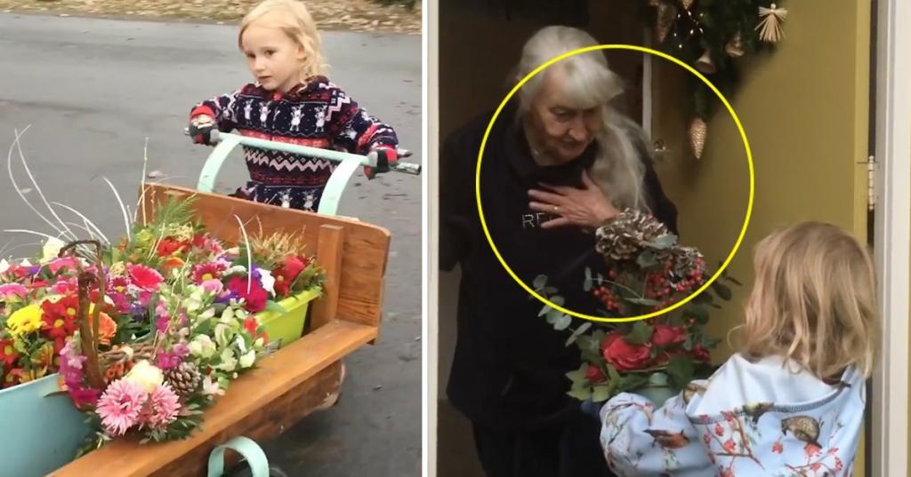 Маленькая девочка раздает цветы, которые не продали в магазине, пожилым людям