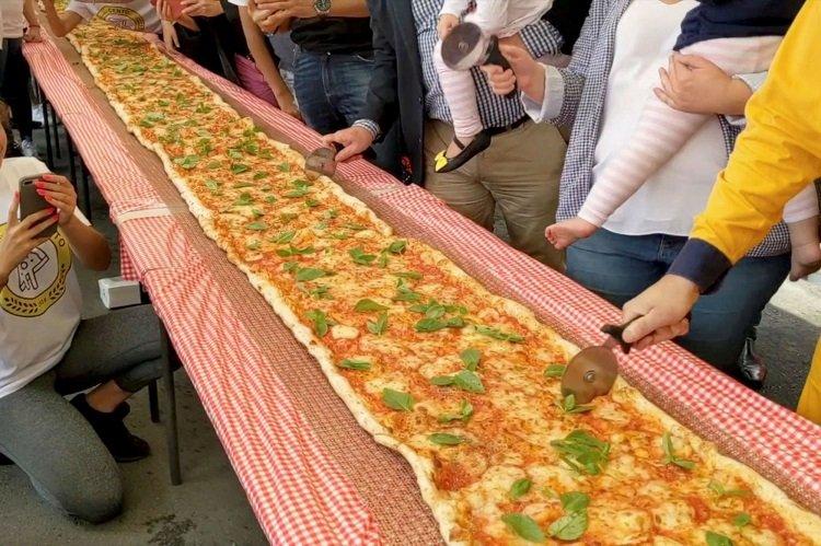 Итальянский ресторан испек пиццу длиной 103 метра: все собранные средства были переданы пожарным Австралии