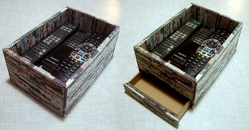 Из газет скрутил трубочки и сделал стильную коробочку для хранения пультов: даже выдвижной ящичек есть