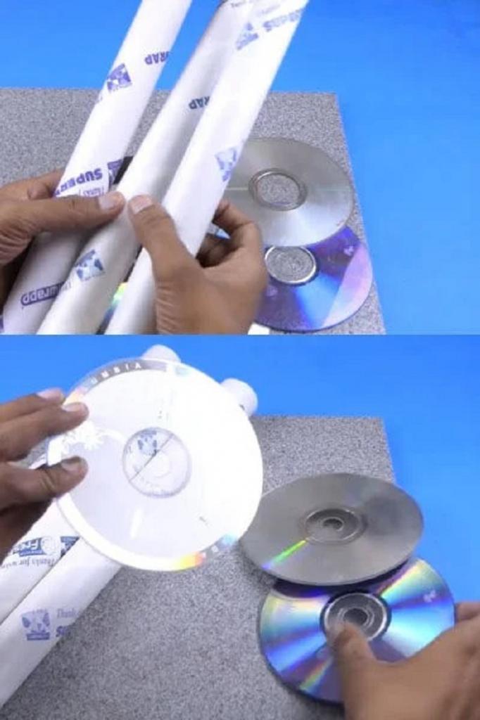 Чтобы хранить все свои лаки для ногтей на видном месте, сделала стильную подставку из CD дисков и картонных трубочек