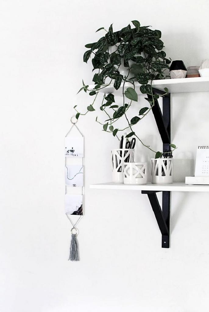 Запечатлеть лучшие моменты и превратить их в настенное украшение: мастерим стильный декор из пряжи и фотографий